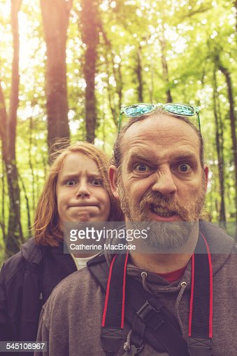 Father and Son pulling faces... : Stock Photo