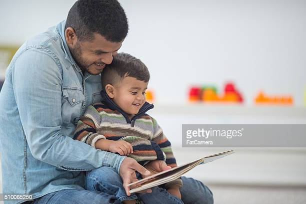 Father and Son Reading Books Together