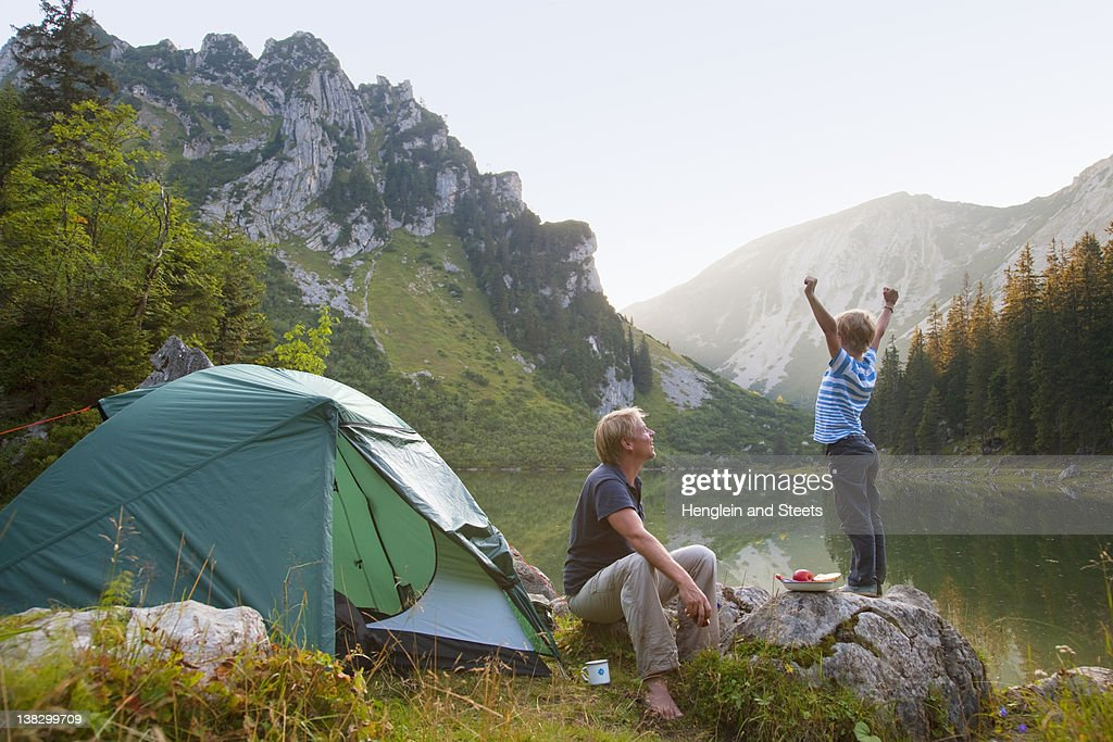 Father and son relaxing at campsite : Stock Photo