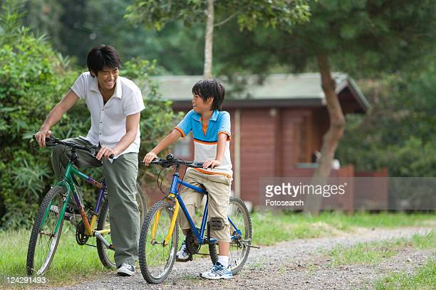 Father and son riding bicycles