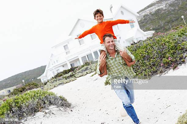 Father and Son Running on Beach