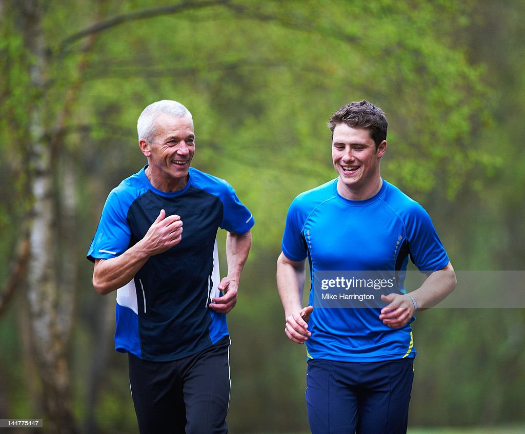 Father and Son Running Together. : Stock Photo