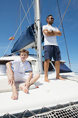 Father and son sailing catamaran off Fuerteventura, Spain