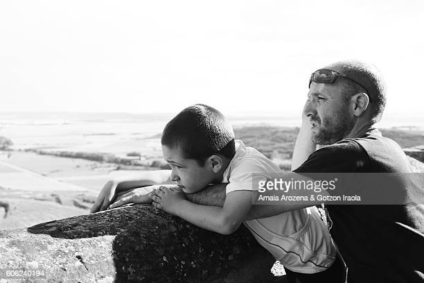 Father and son scanning the horizon
