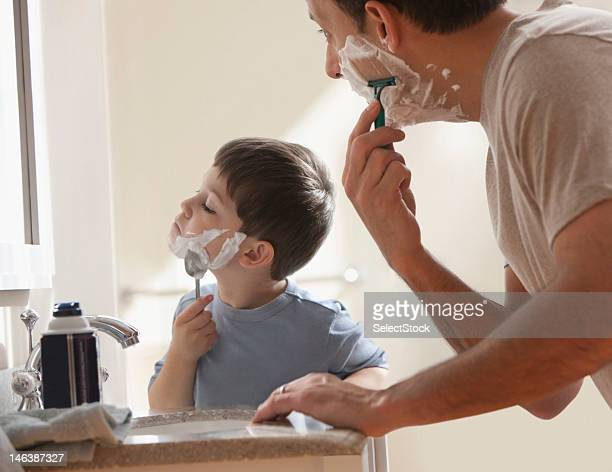 Father and son shaving together