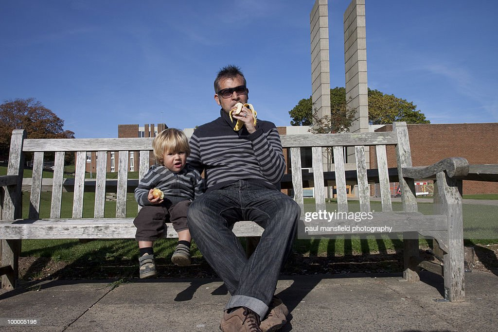 Father and son sitting together : Stock Photo