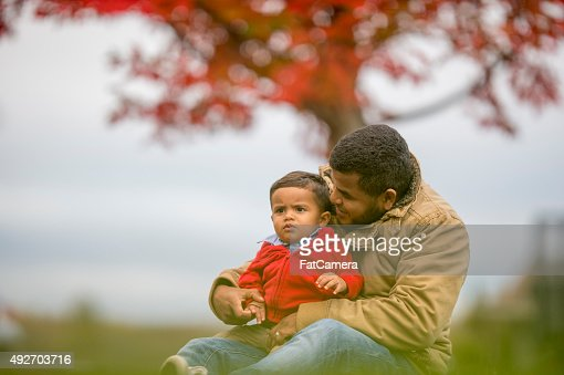 Father and Son Sitting Under a Tree