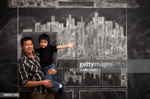 father and son smile by facebook chalkboard : Stock Photo