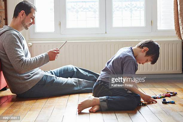 Father and son spending time in living room