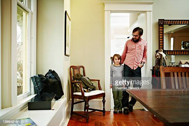 Father and son standing in doorway