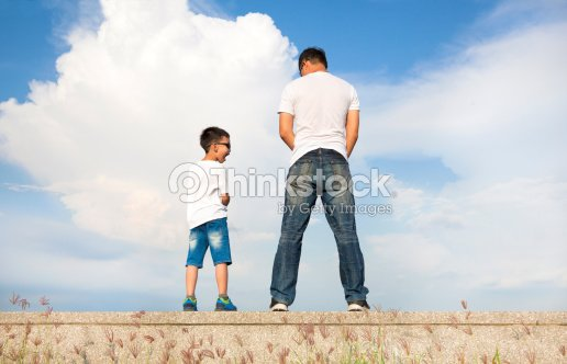 cabd9a73a Father And Son Standing On A Stone Platform And Pee Together Stock ...