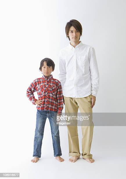 Father and son standing side by side