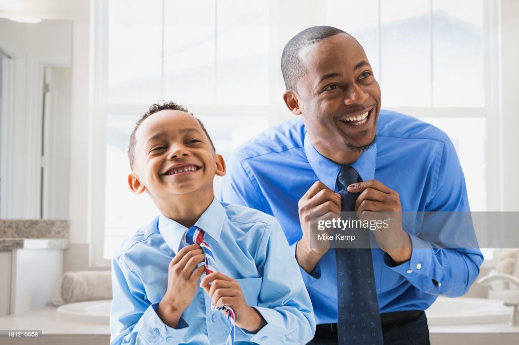 Father and son straightening their ties