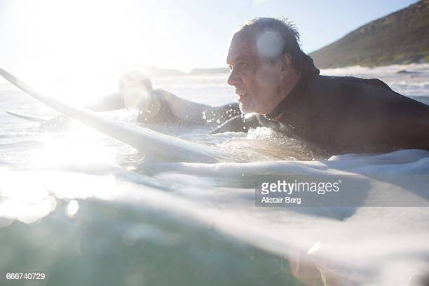 Father and son surfing together
