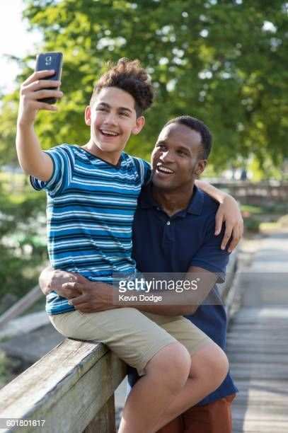 Father and son taking selfie outdoors
