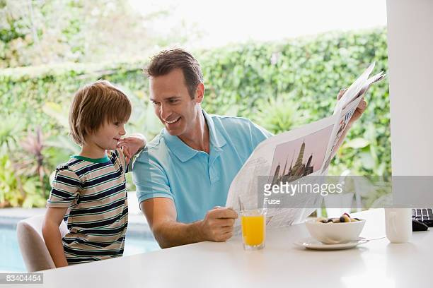 Father and Son Talking About the News