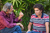 Father and son talking on a bench