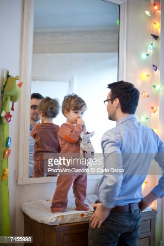 Father and son together in nursery