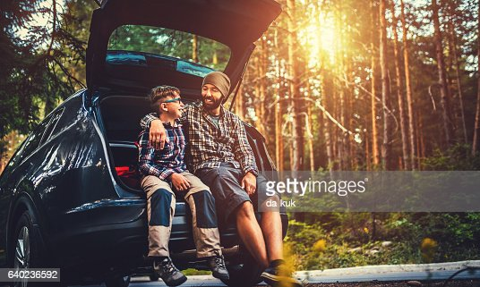 Father and son travelling by car