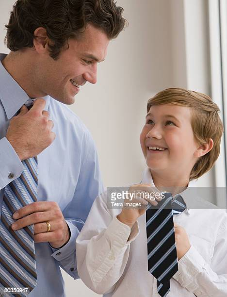 Father and son tying neckties
