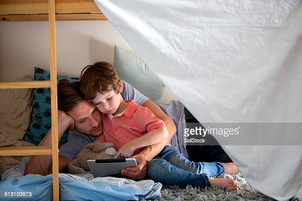 Father and Son Using a Electronic Tablet