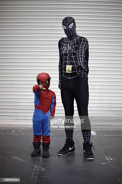 A father and son visit the London Super Comic Convention both dressed as Spiderman at ExCel on February 25 2012 in London England Visitors to the...