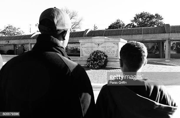 Father and son visit the tomb of Martin Luther King Jr and Coretta Scott King during Martin Luther King Jr Day parade at the MLK Center on January 18...