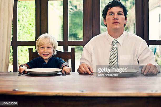 Father and son waiting for their dinner