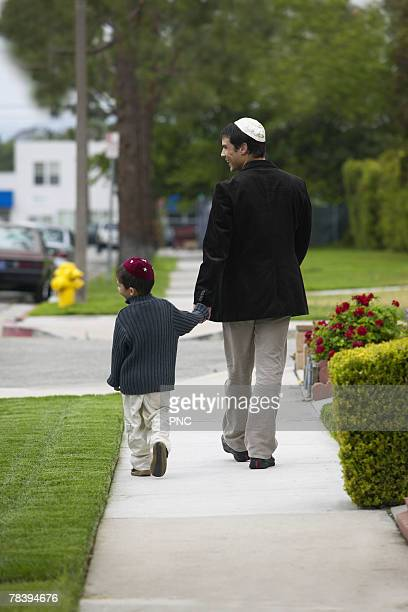 Father and son walking and holding hands