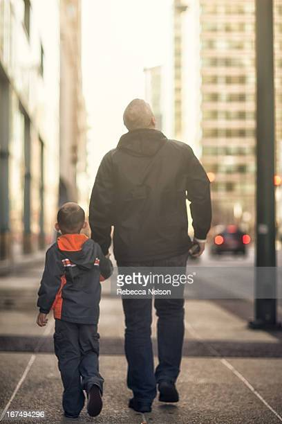 Father and son walking down the streets of Chicago