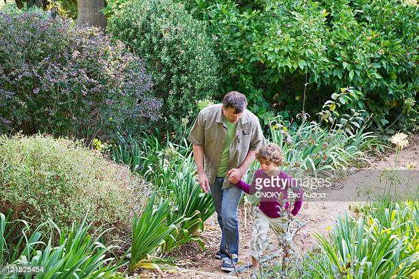 Father and son walking in a garden