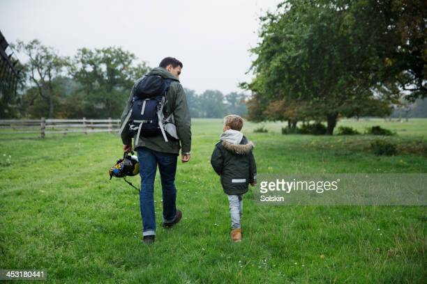 Father and son walking in nature