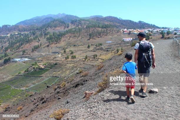Father and son walking in San Antonio volcano's crater in Fuencaliente. La Palma island, Canary islands