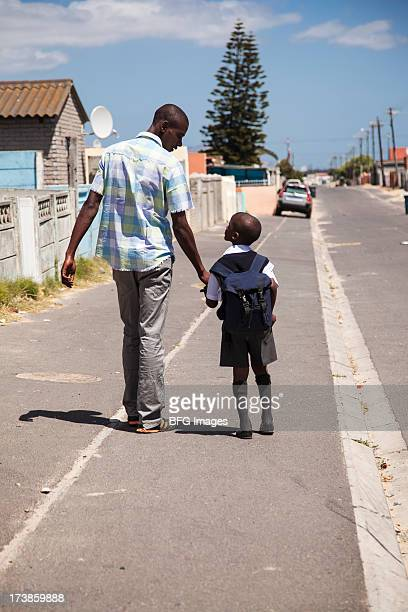 Father and son walking in Street, Cape Town, South Africa