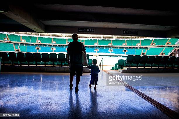 A father and son walking inside Arena Fonte Nova.