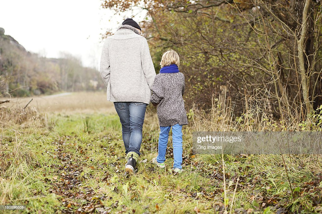 Father and son walking outdoors : Stock Photo