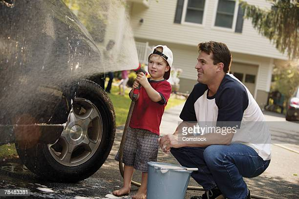 Father and son washing car