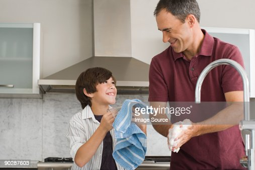 Father and son washing up : Stock Photo