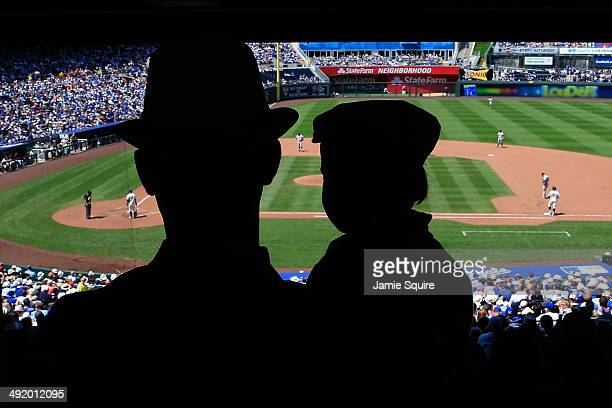 A father and son watch the game between the Baltimore Orioles and the Kansas City Royals at Kauffman Stadium on May 18 2014 in Kansas City Missouri...