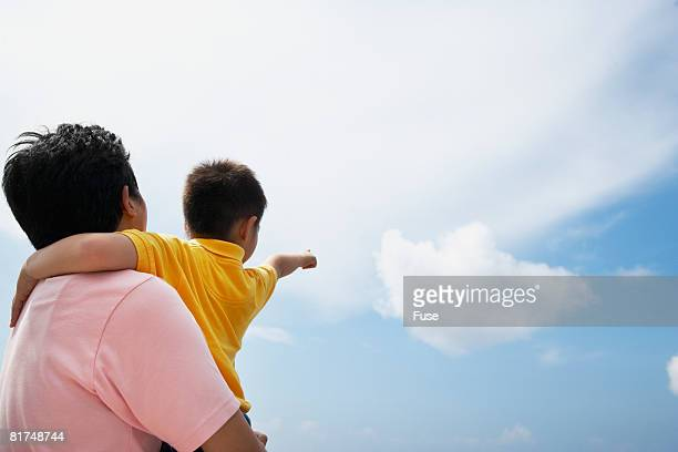 Father and Son Watching Clouds