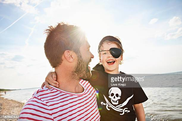 Father and son wearing pirate costumes