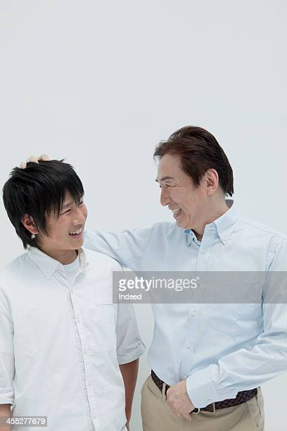 Father and son who is talking