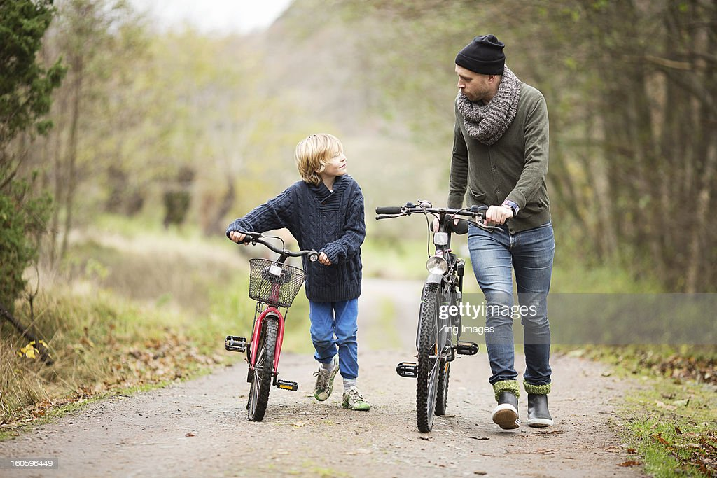 Father and son with bicycles : Stock Photo
