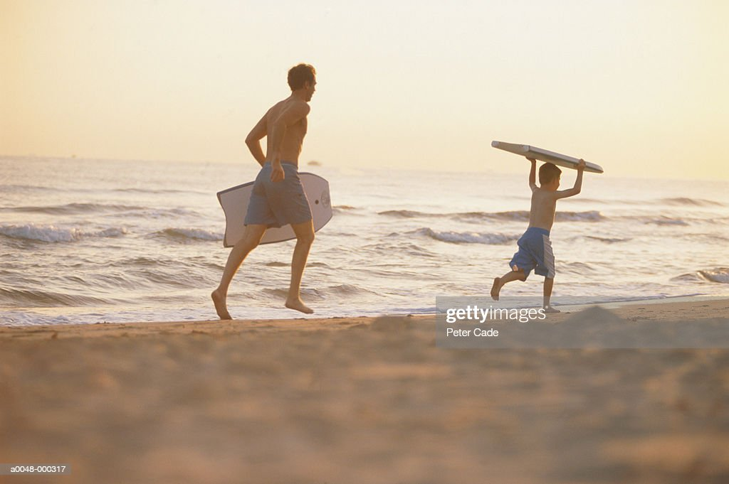 Father and Son With Bodyboards