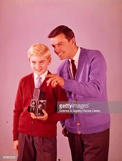 Father and son with camera Photographic Advertising Limited founded in 1926 created multipurpose stock images with the potential for selling a range...