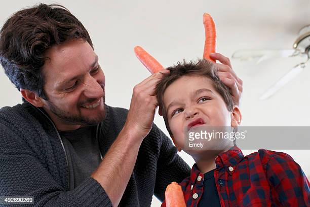 Father and son with carrot horns