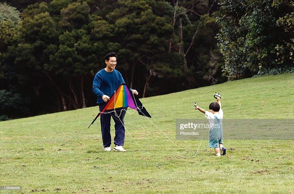 Father and Son with Kite : Stock Photo
