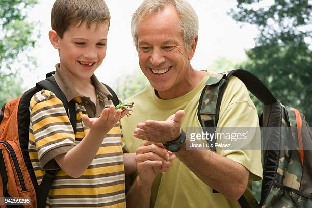 Father and son with lizard