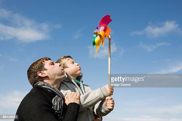Father and son with pinwheel