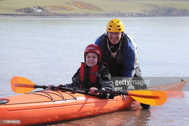father and son with sea kayak